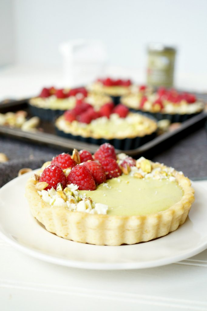mini raspberry pistachio tartlets
