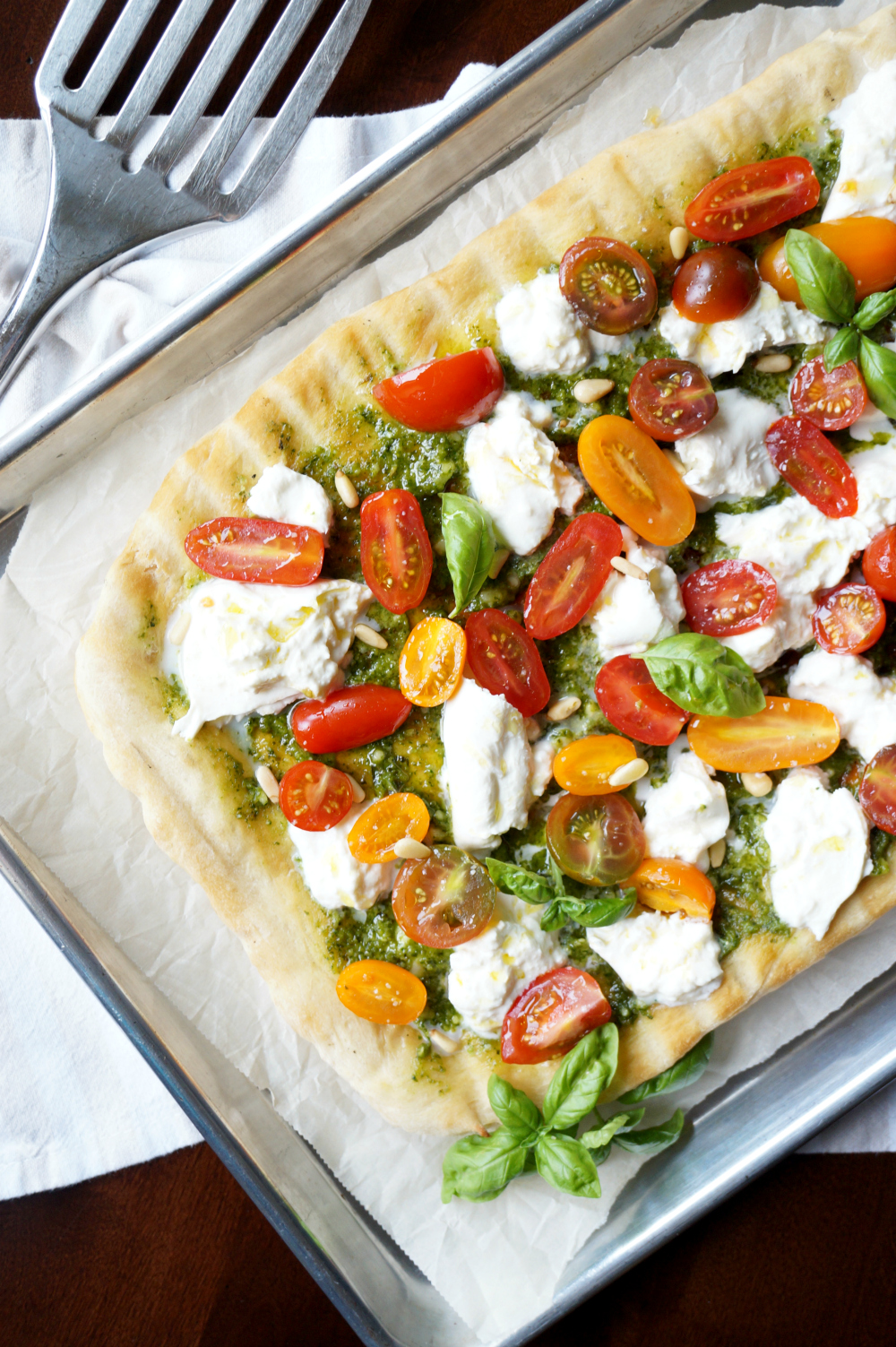 grilled pizza with pesto, burrata, and baby tomatoes | The Baking Fairy