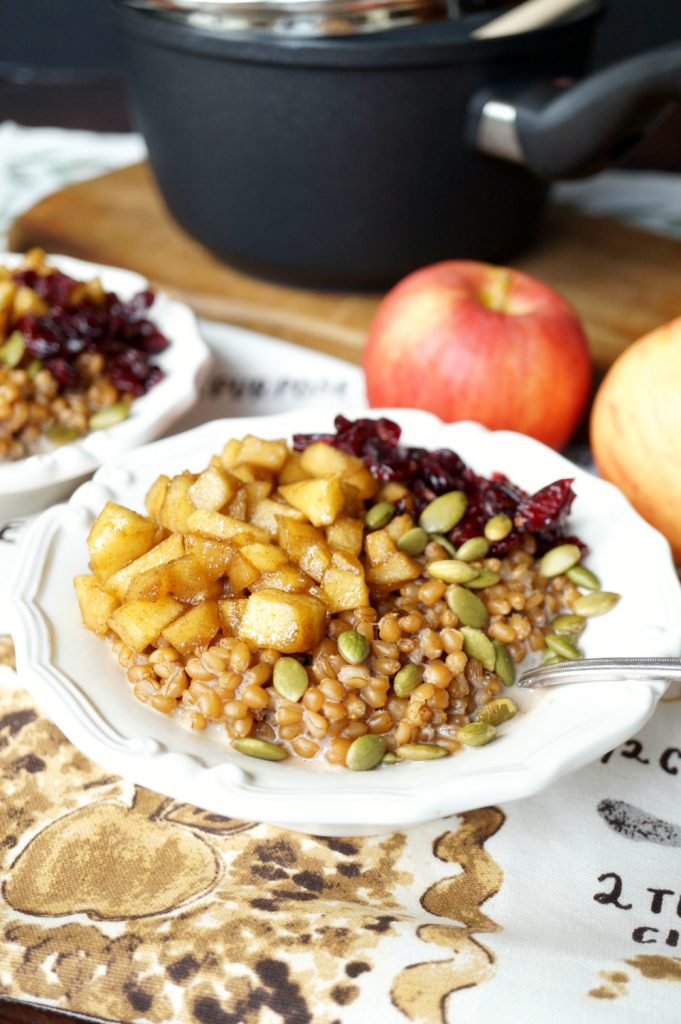 caramelized apple wheatberry porridge with cranberries and pepitas #AppleWeek | The Baking Fairy