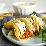 BBQ chickpea tacos close up topped with slaw