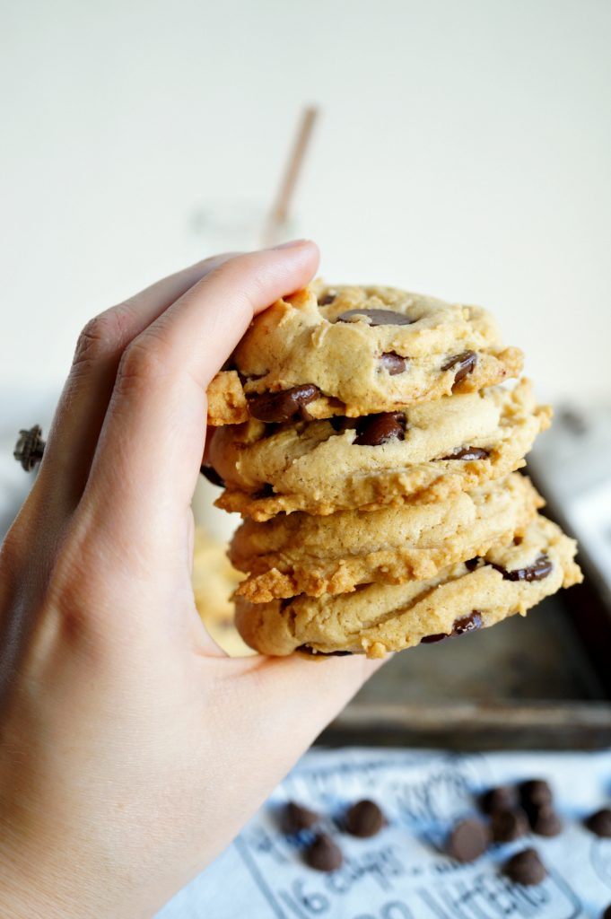 stack of vegan chocolate chip cookies in hand