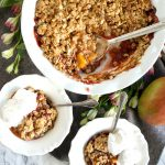 overhead bowls of mango raspberry crumble