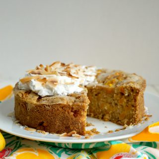 mango coconut snack cake with slice missing