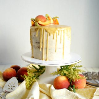 peaches & cream cake on stand