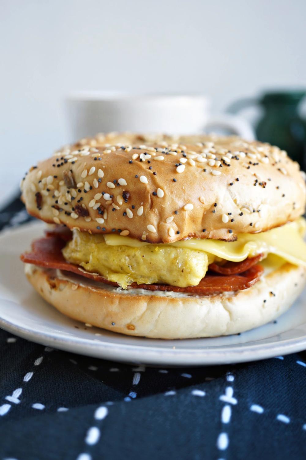 close up of breakfast bagel sandwich