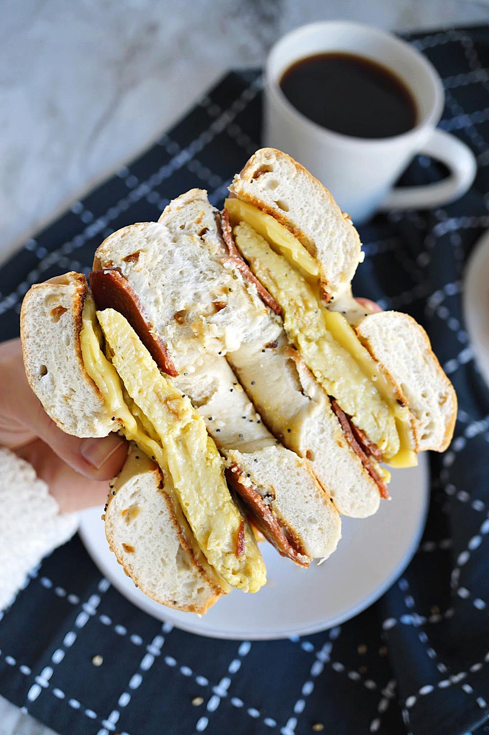 breakfast bagel sandwich cut in half