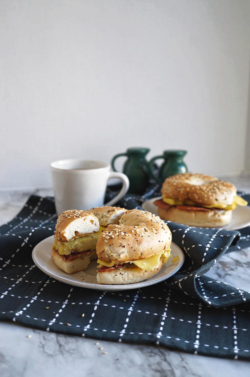 two breakfast bagel sandwiches