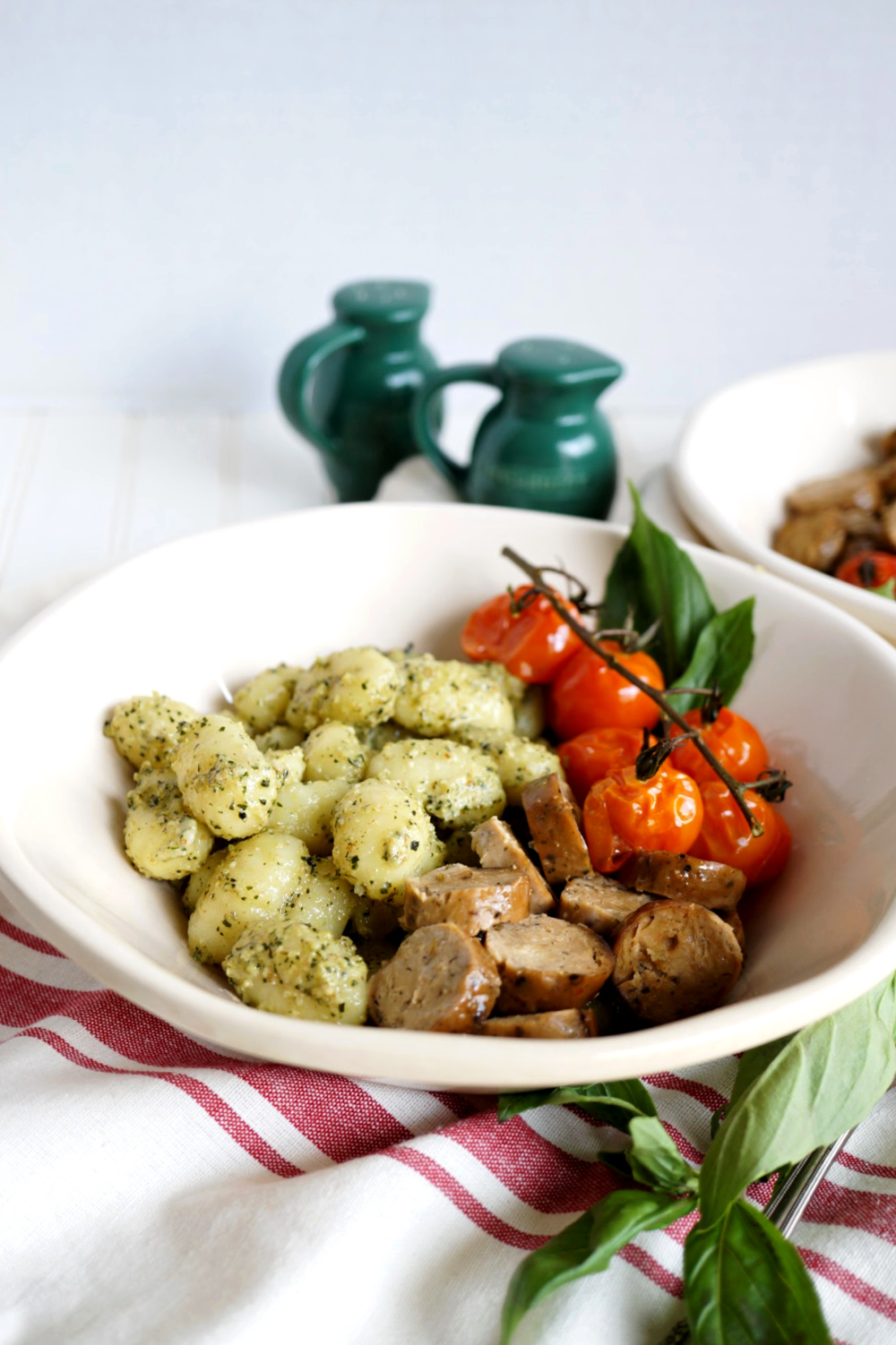 plate of gnocchi with sausage and tomatoes