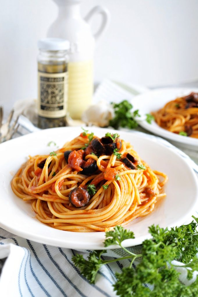 plate of pasta puttanesca spaghetti