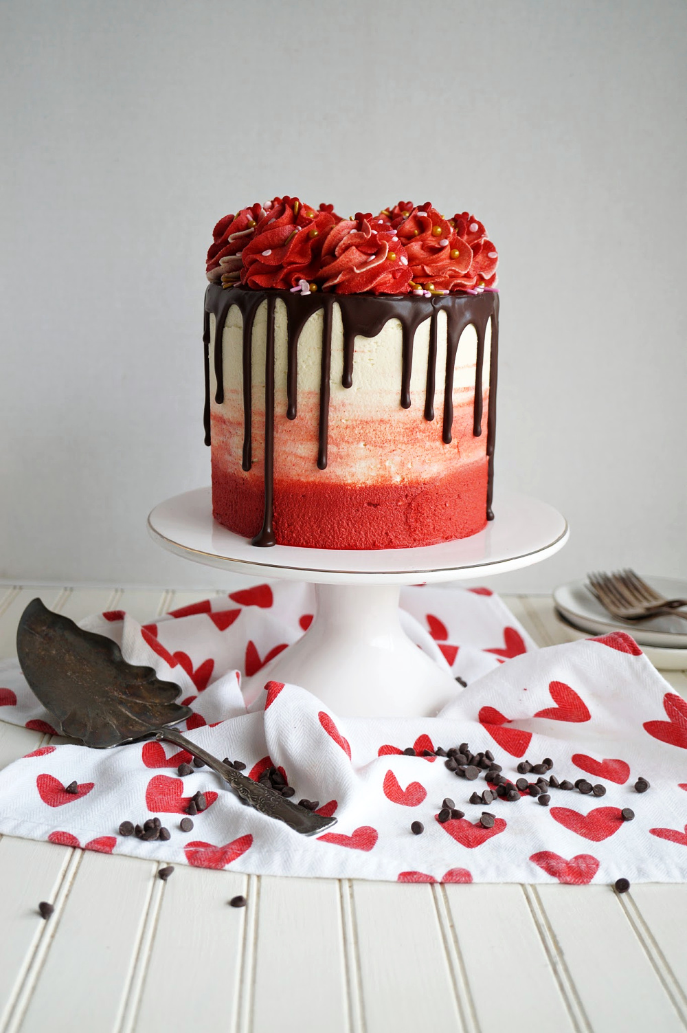 red velvet chocolate chip cake on stand