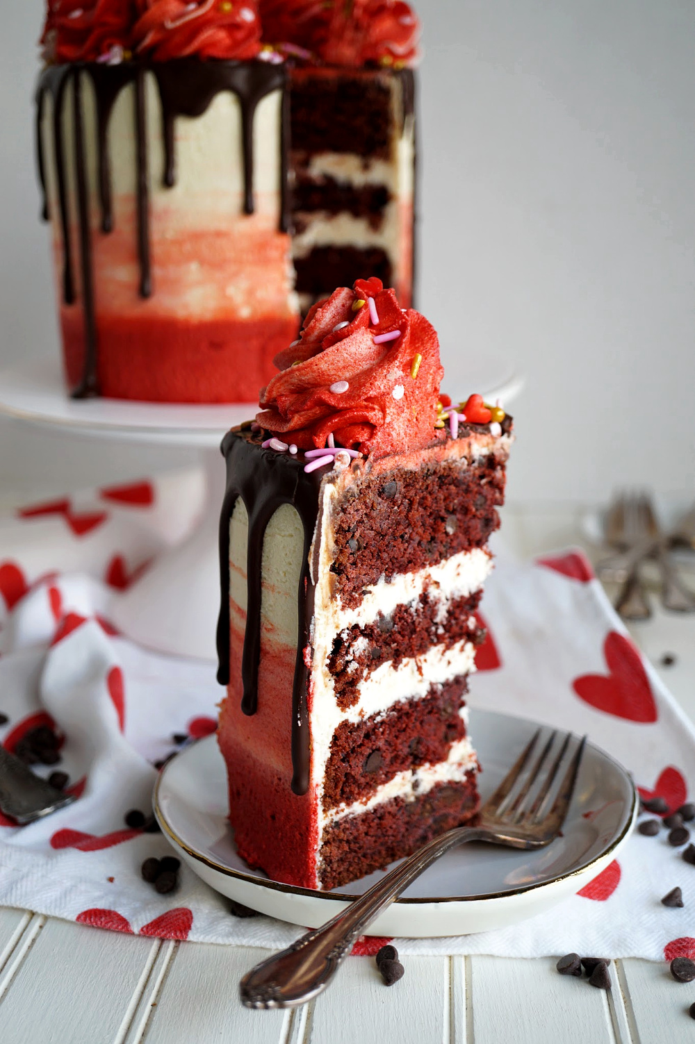 cut slice of red velvet chocolate chip cake