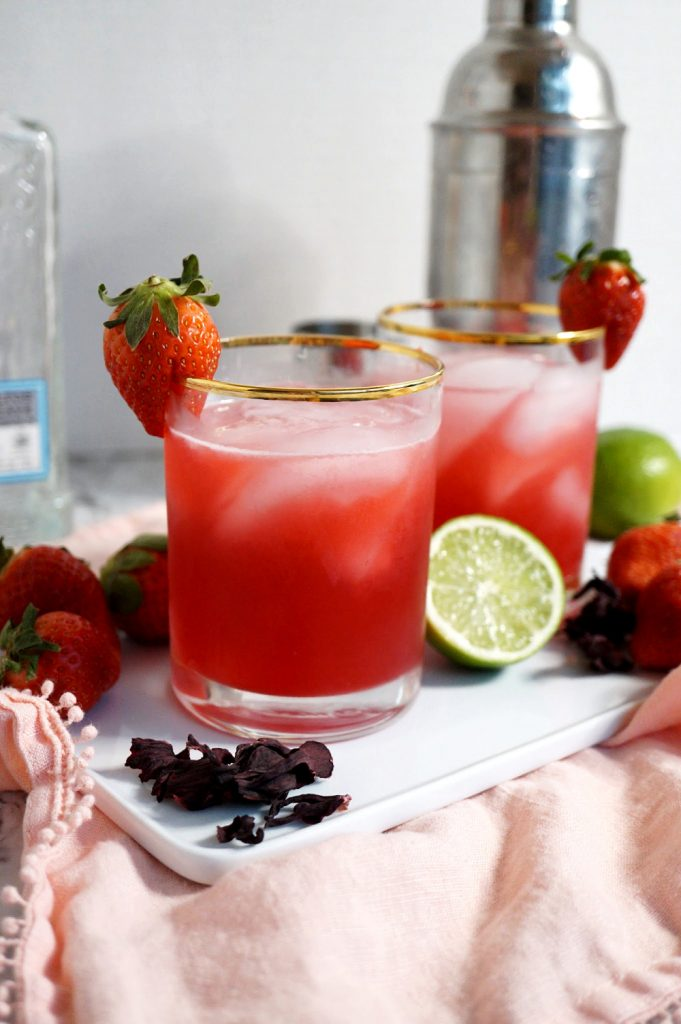 two glasses of strawberry hibiscus margaritas