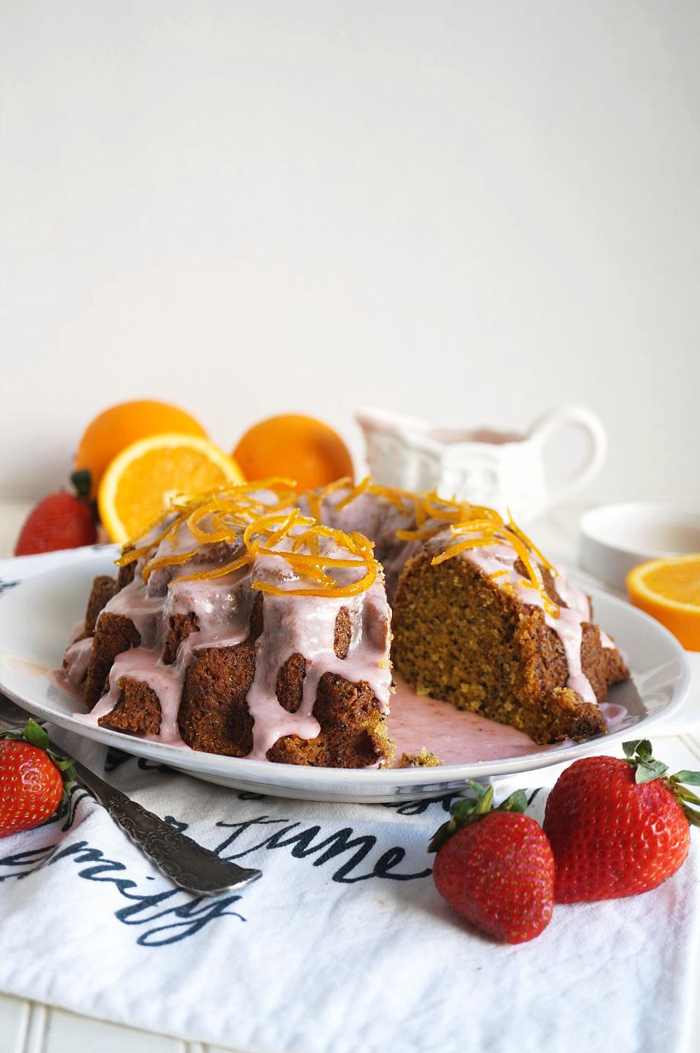 orange poppyseed bundt cake with slice cut