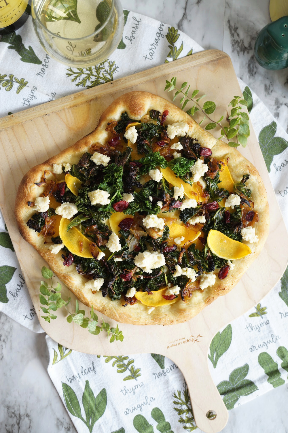 overhead shot of pizza with kale and butternut squash