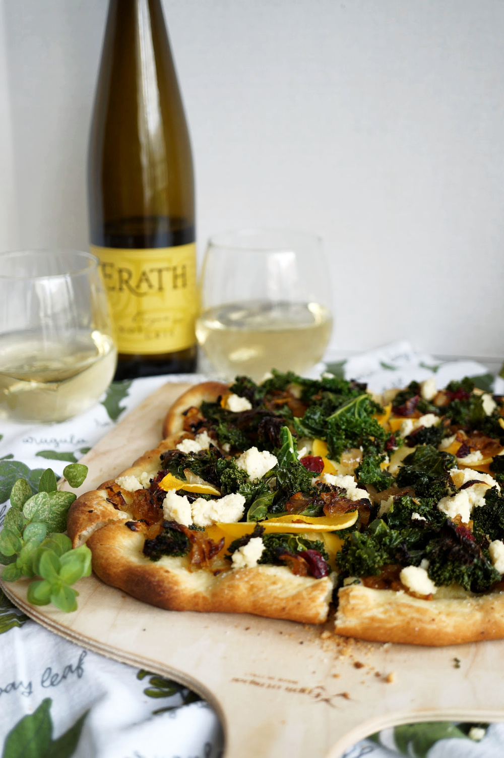 pizza with wine bottle in the background