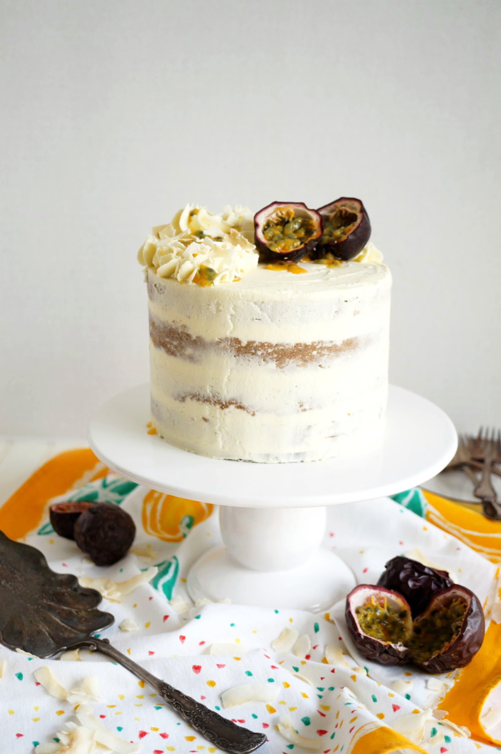 coconut layer cake with passionfruit curd on cake stand