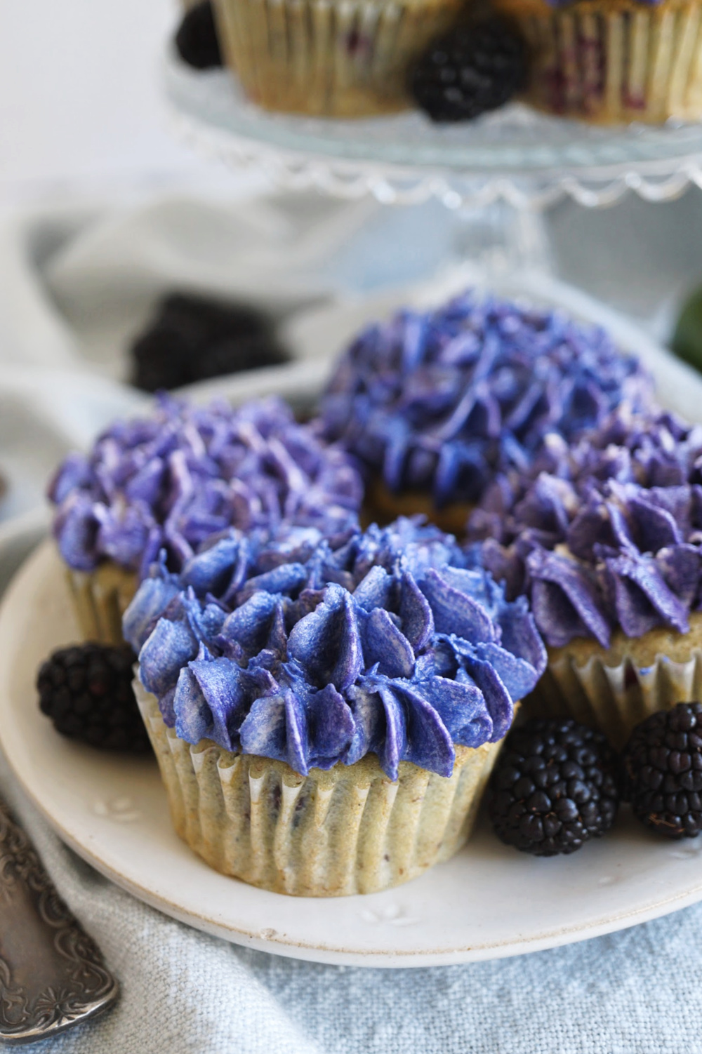 close up of a cupcake with hydrangea frosting