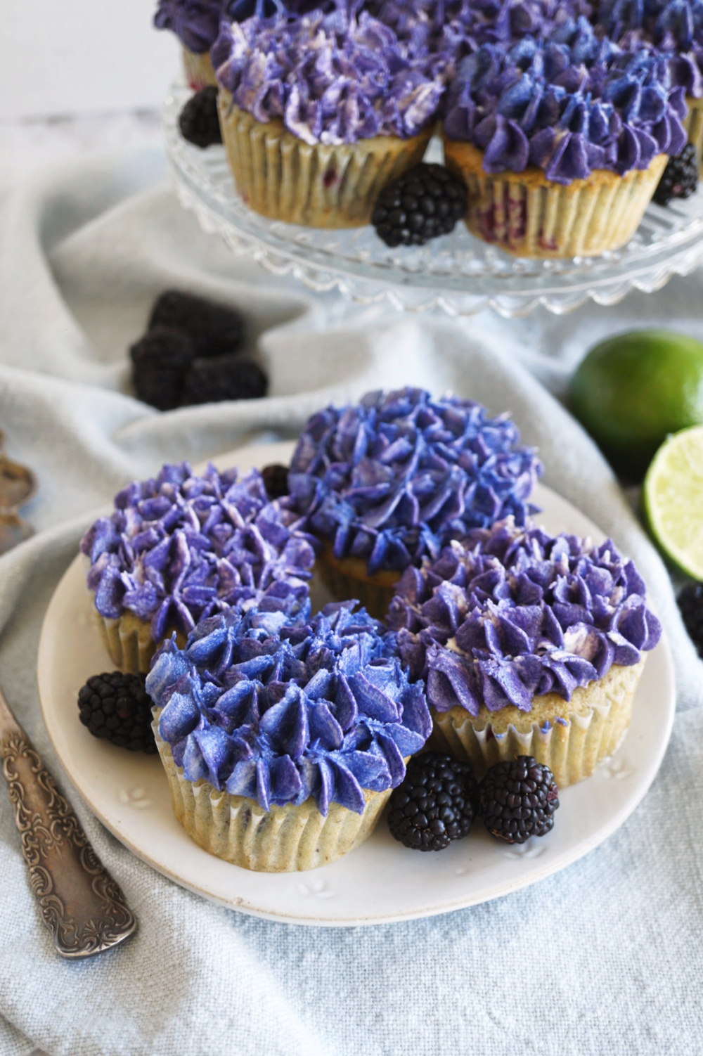 blackberry lime cupcakes on a plate