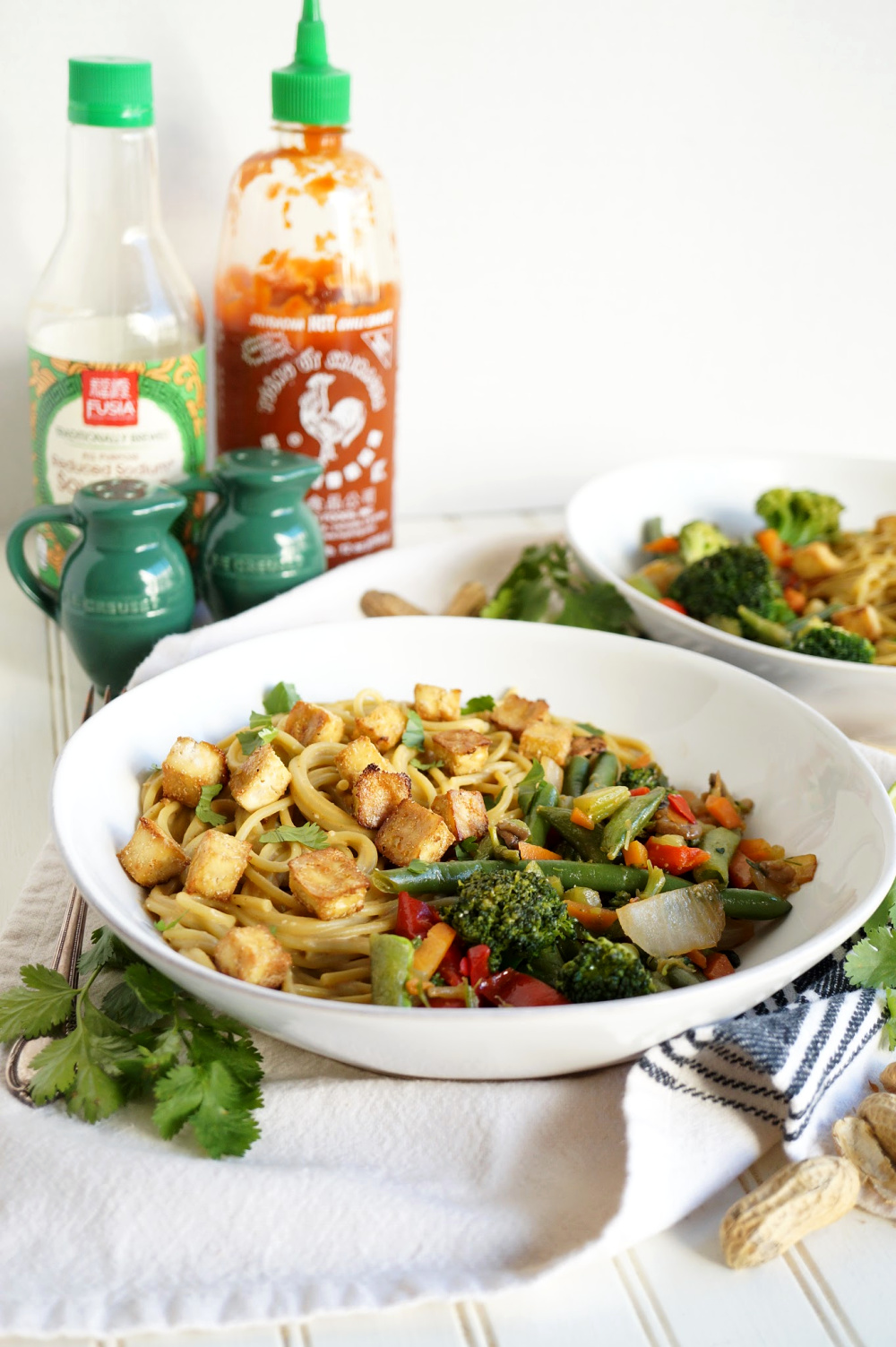 plate of peanut noodles with vegetable stir fry