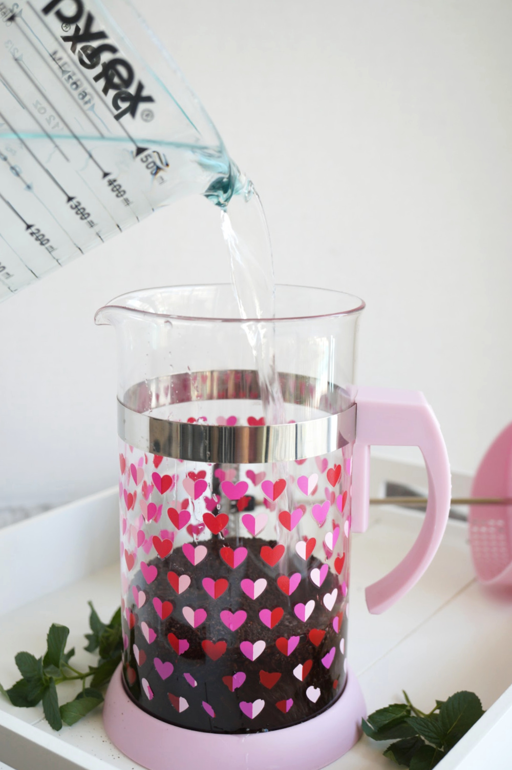 pouring water into french press