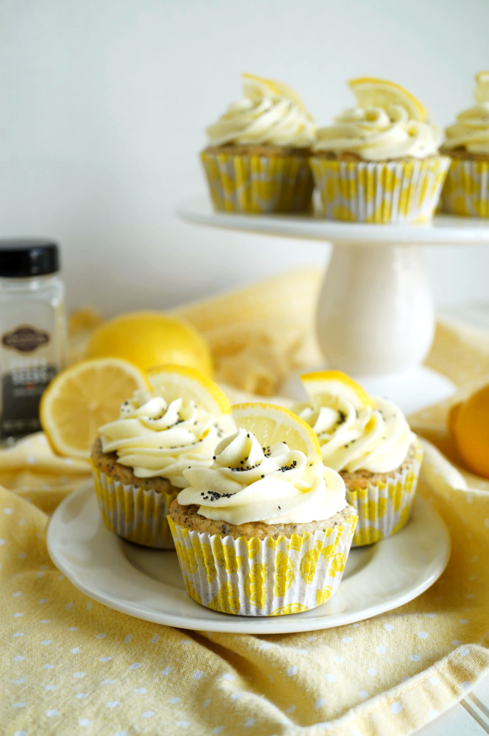 vegan lemon poppyseed cupcakes on a plate