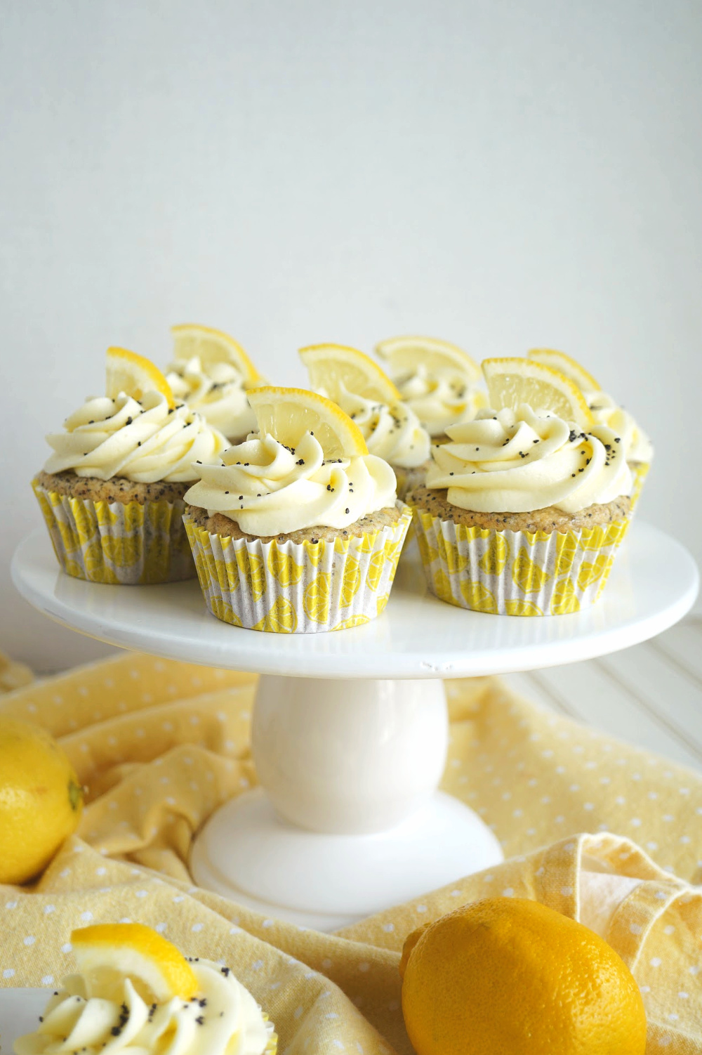 lemon poppyseed cupcakes on cake stand