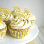 lemon poppyseed cupcake on cake stand
