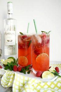 two glasses of raspberry coconut mojitos