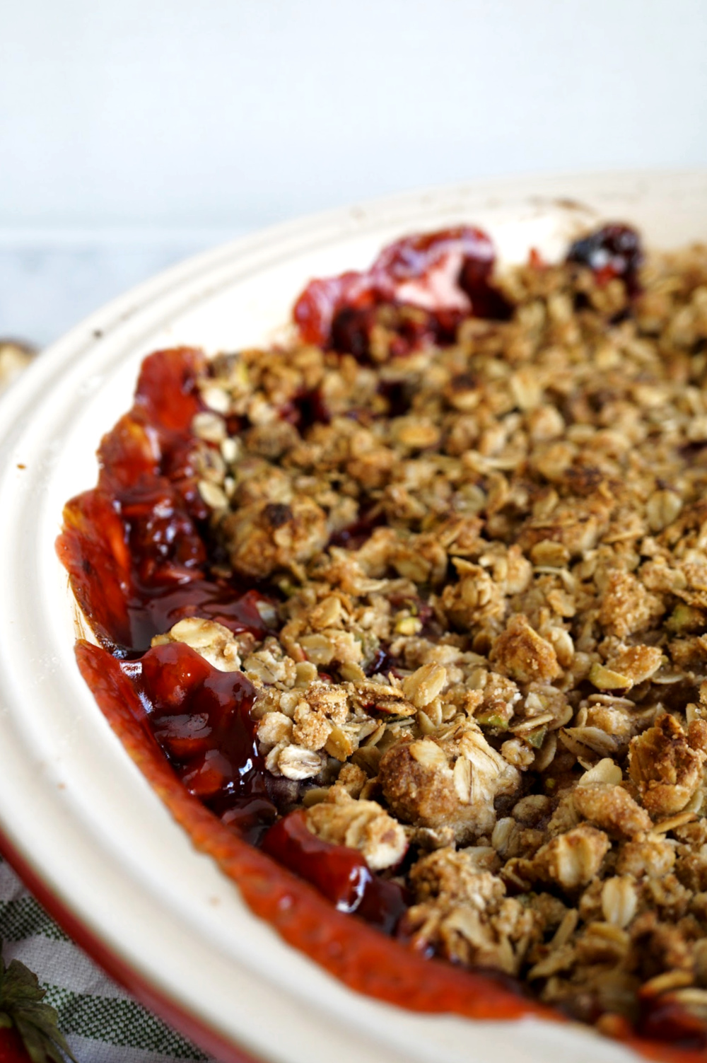 close up of crumble oat topping on strawberry crisp