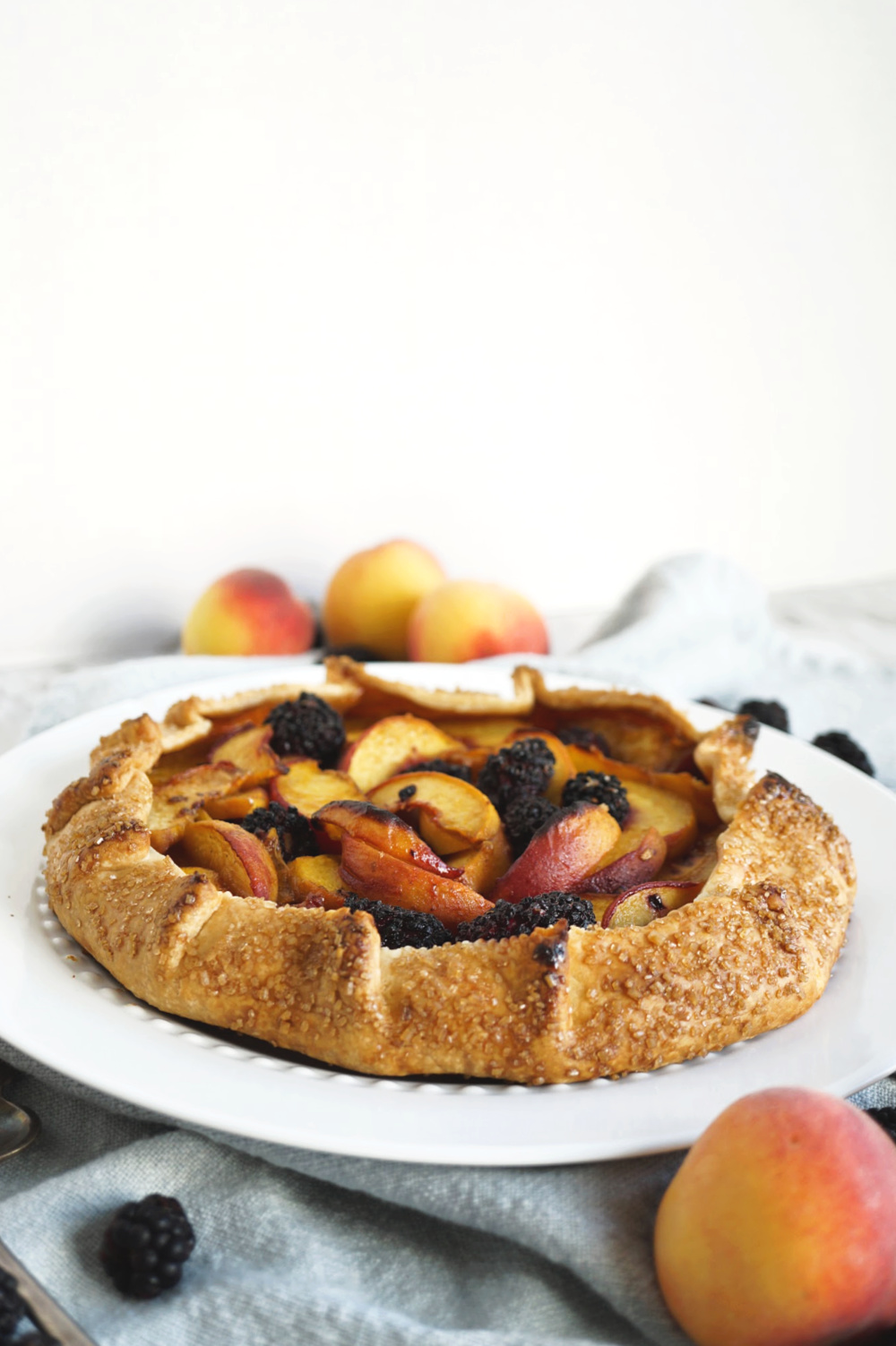 blackberry peach galette on serving plate