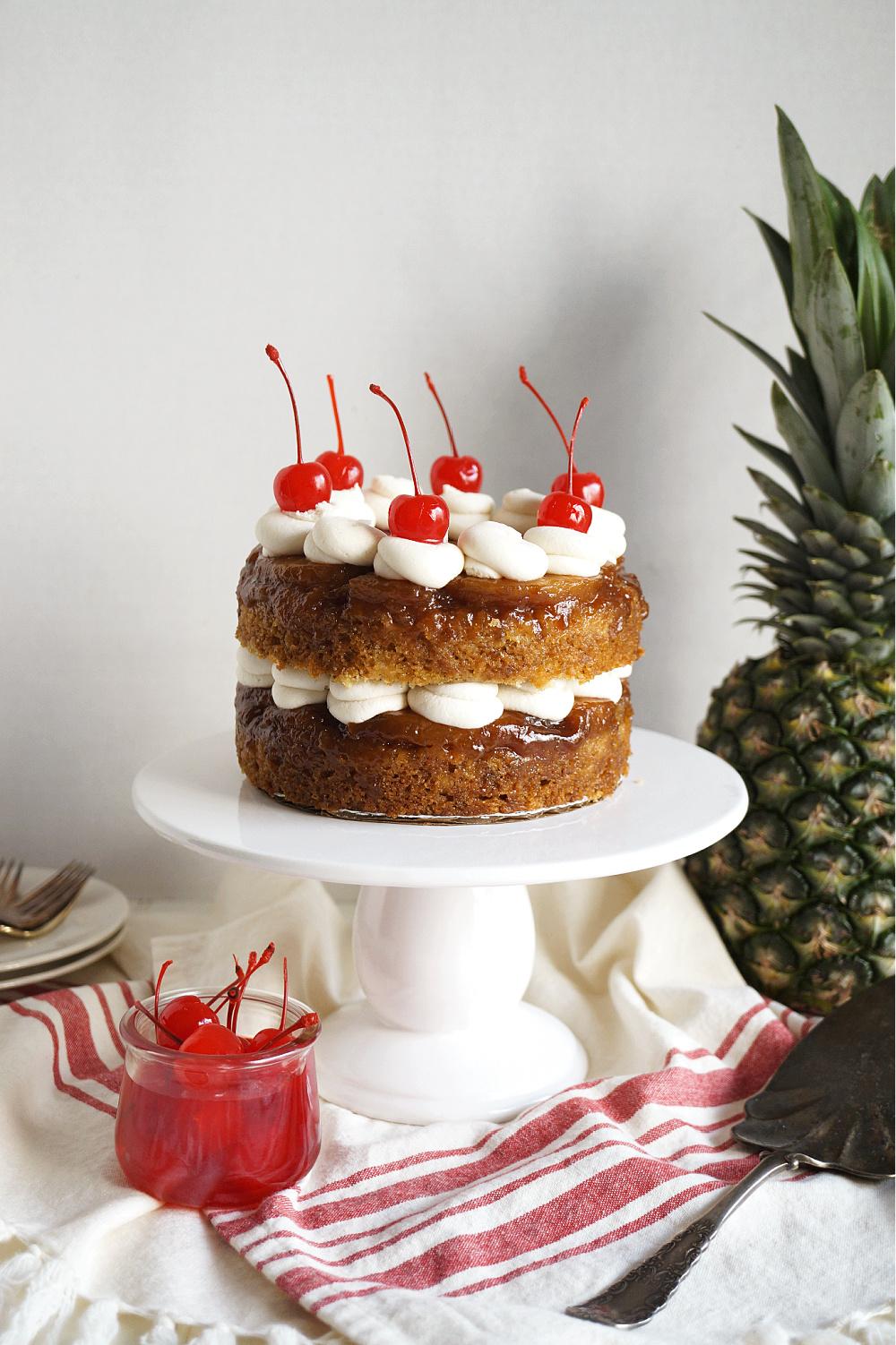 vegan pineapple upside down layer cake on cake stand