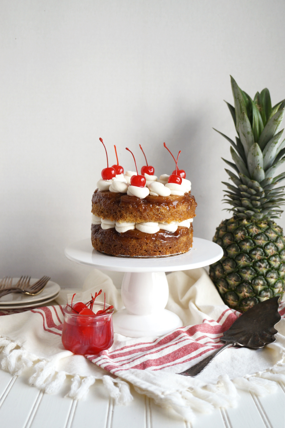 pineapple upside down cake on cake stand