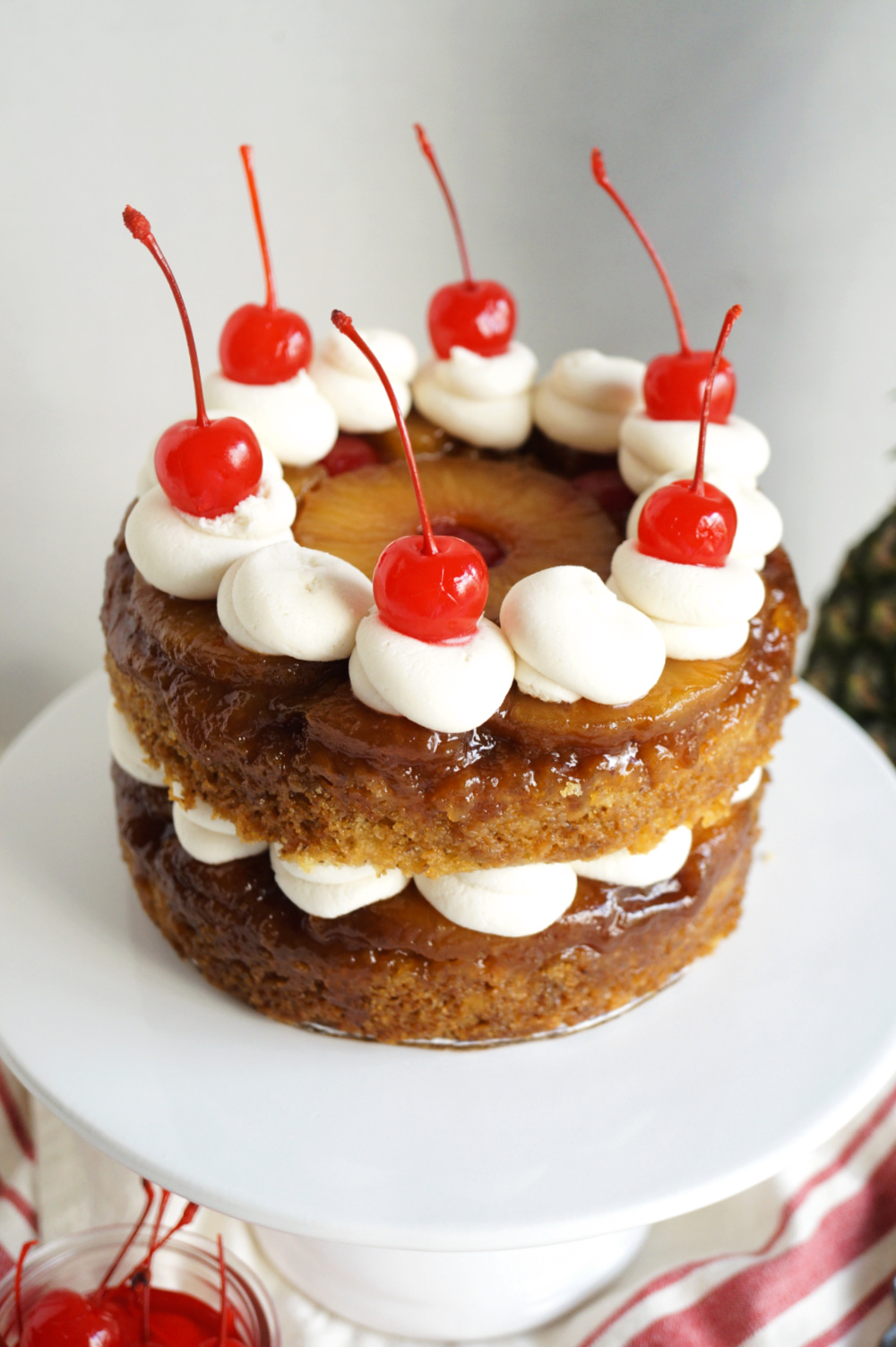 angled view of pineapple upside down layer cake