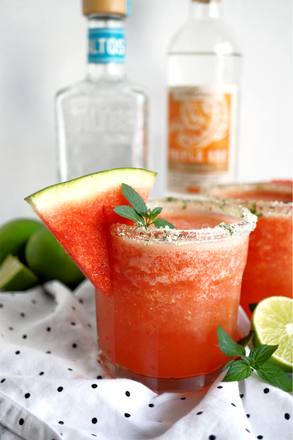 close up of a cup of watermelon mint frozen margaritas