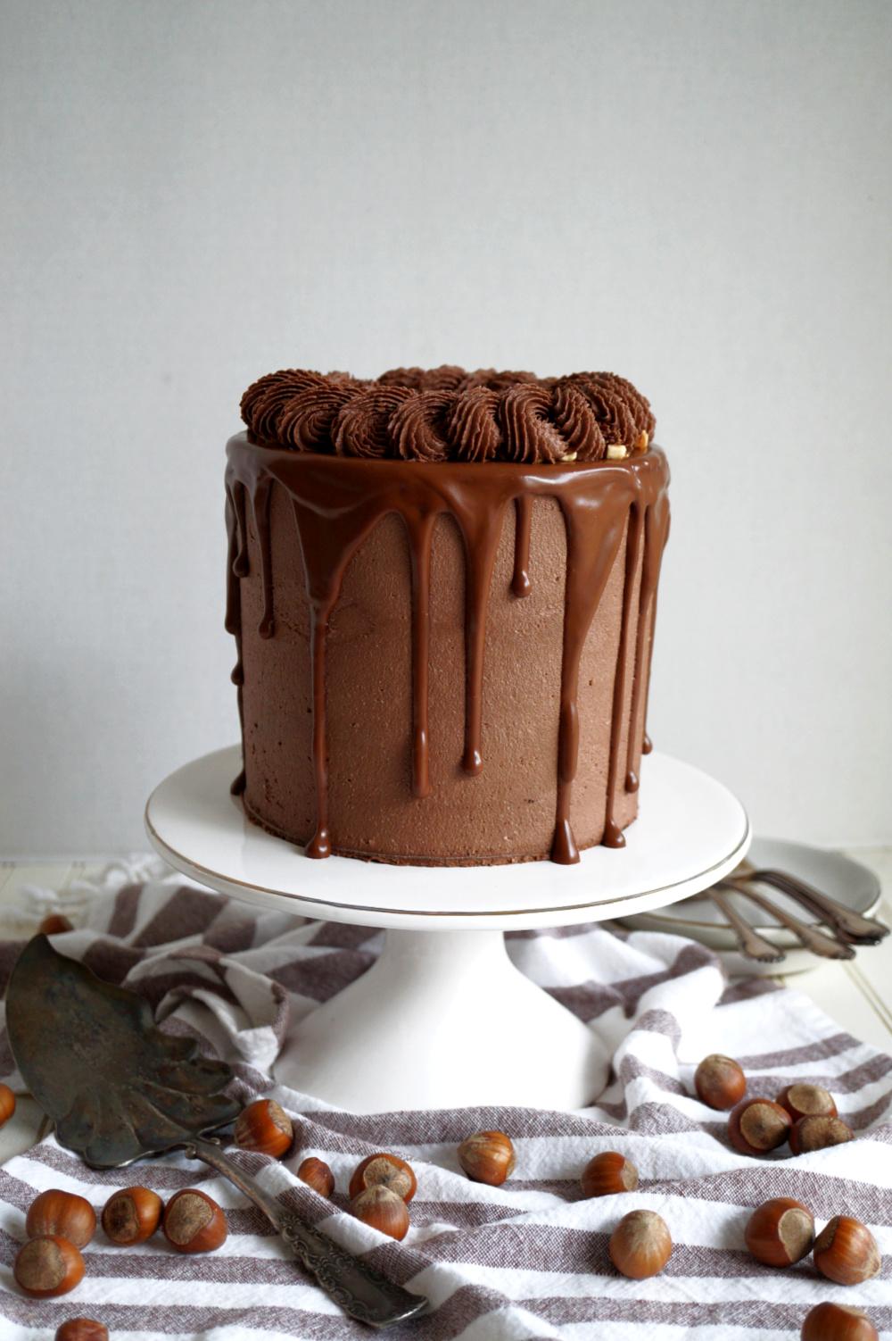 chocolate hazelnut layer cake on cake stand