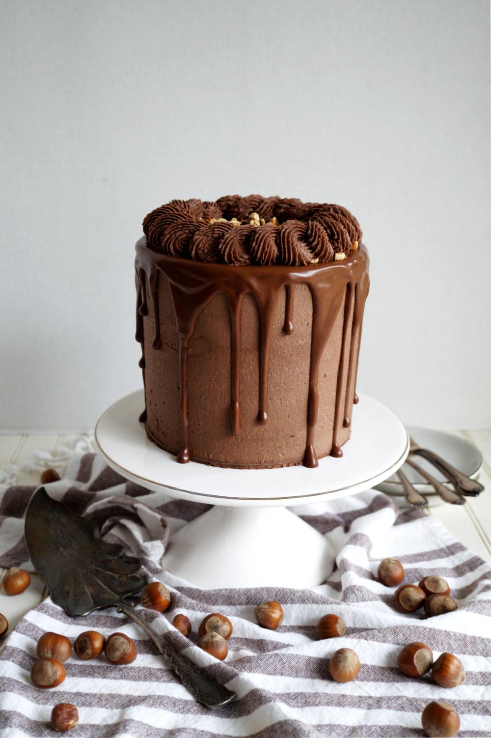 photo of chocolate hazelnut cake on stand