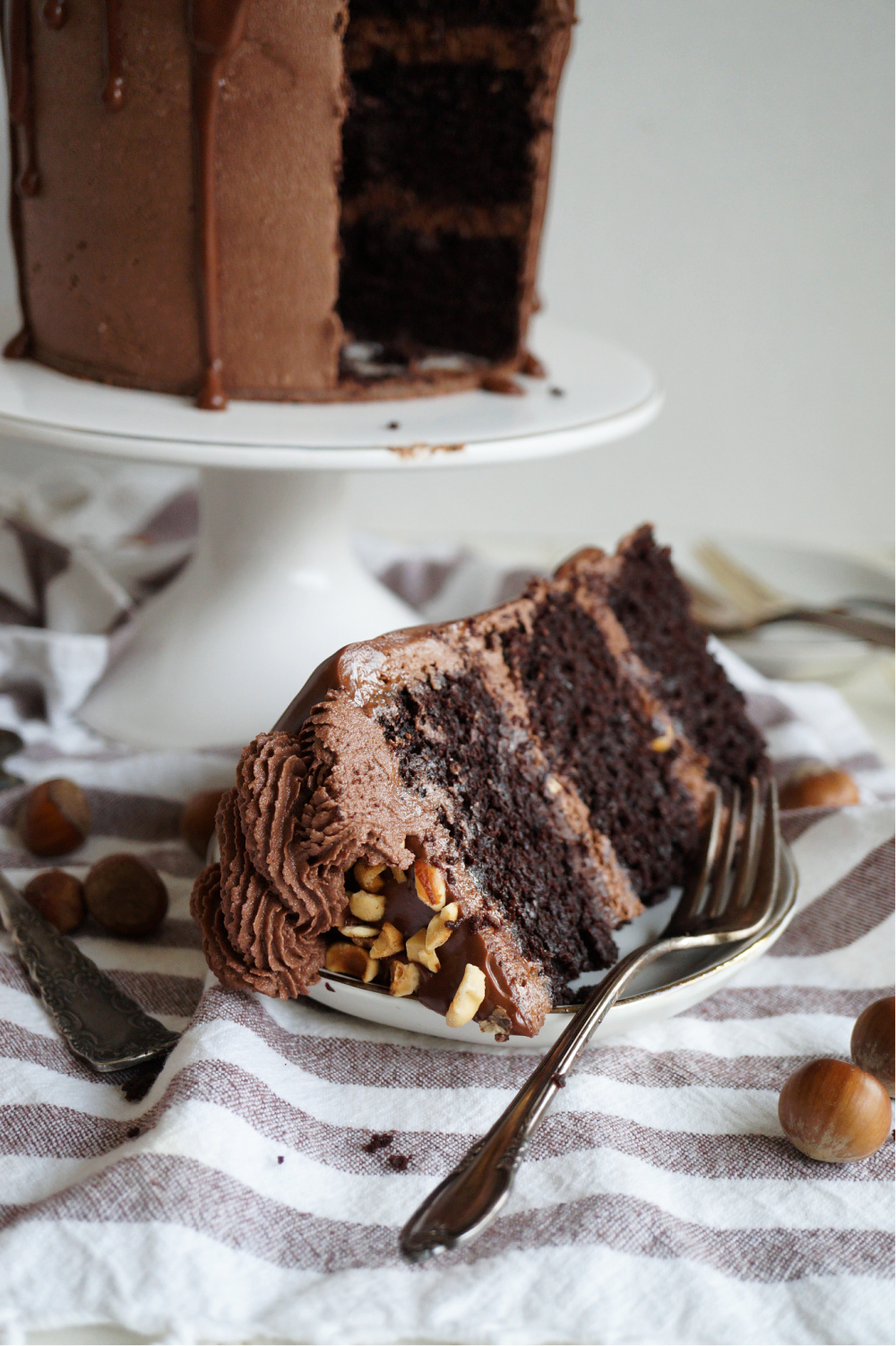 slice of chocolate hazelnut cake on plate