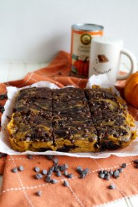 head-on shot of pumpkin swirl brownies on parchment