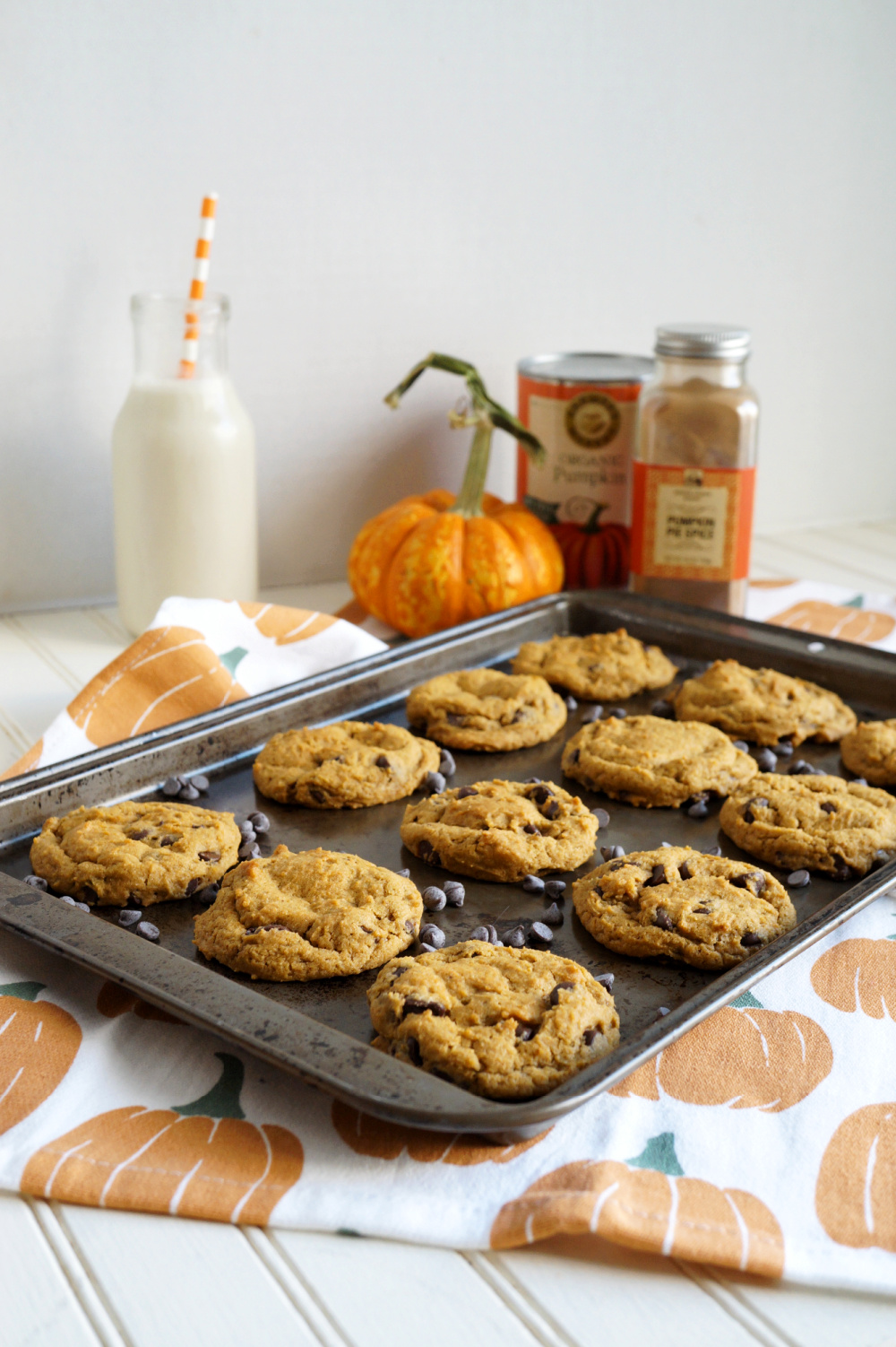 pumpkin chocolate chip cookies on cookie sheet