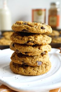 close up of a stack of pumpkin chocolate chip cookies