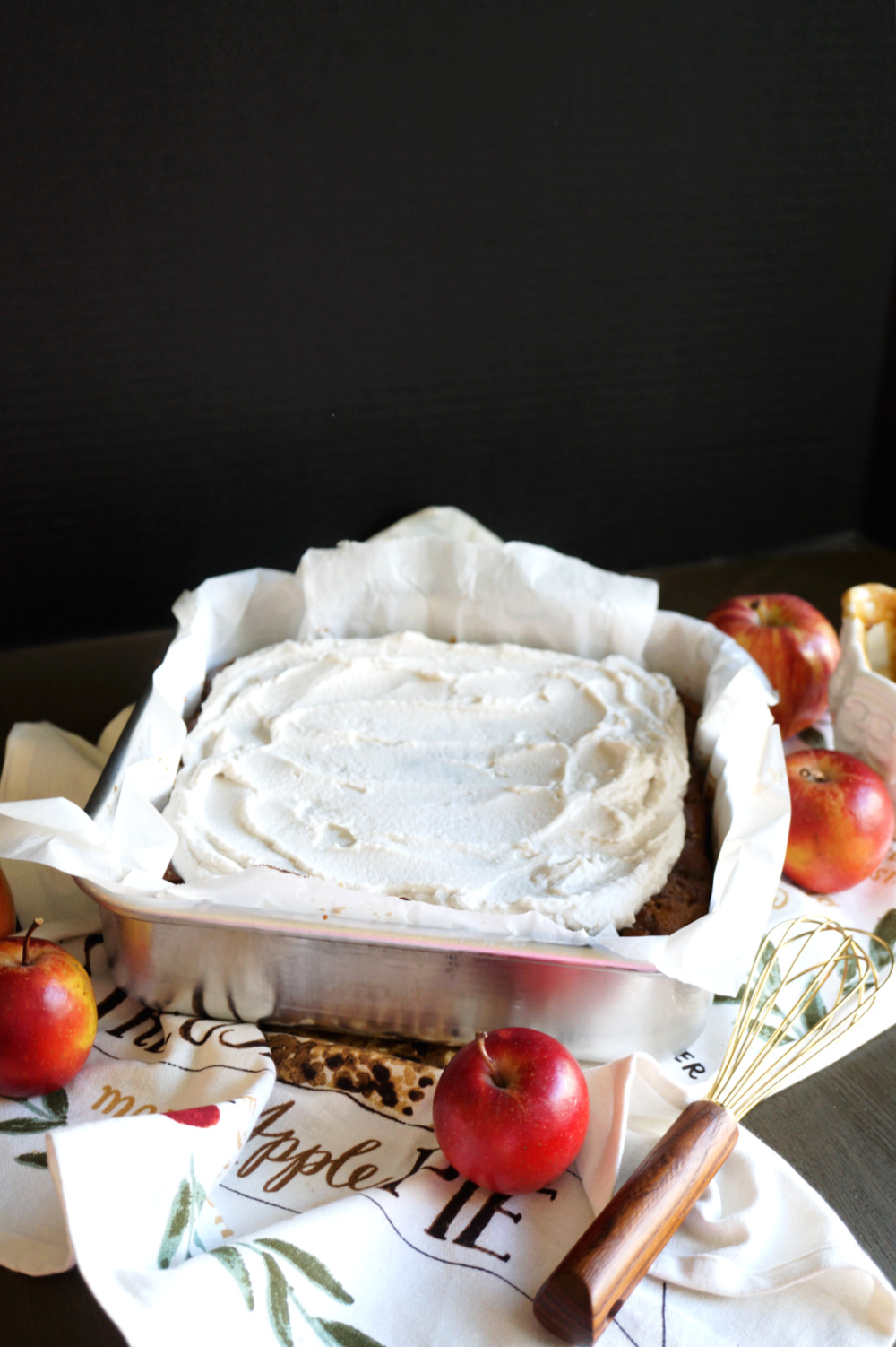 caramel apple cake with whipped cream on top