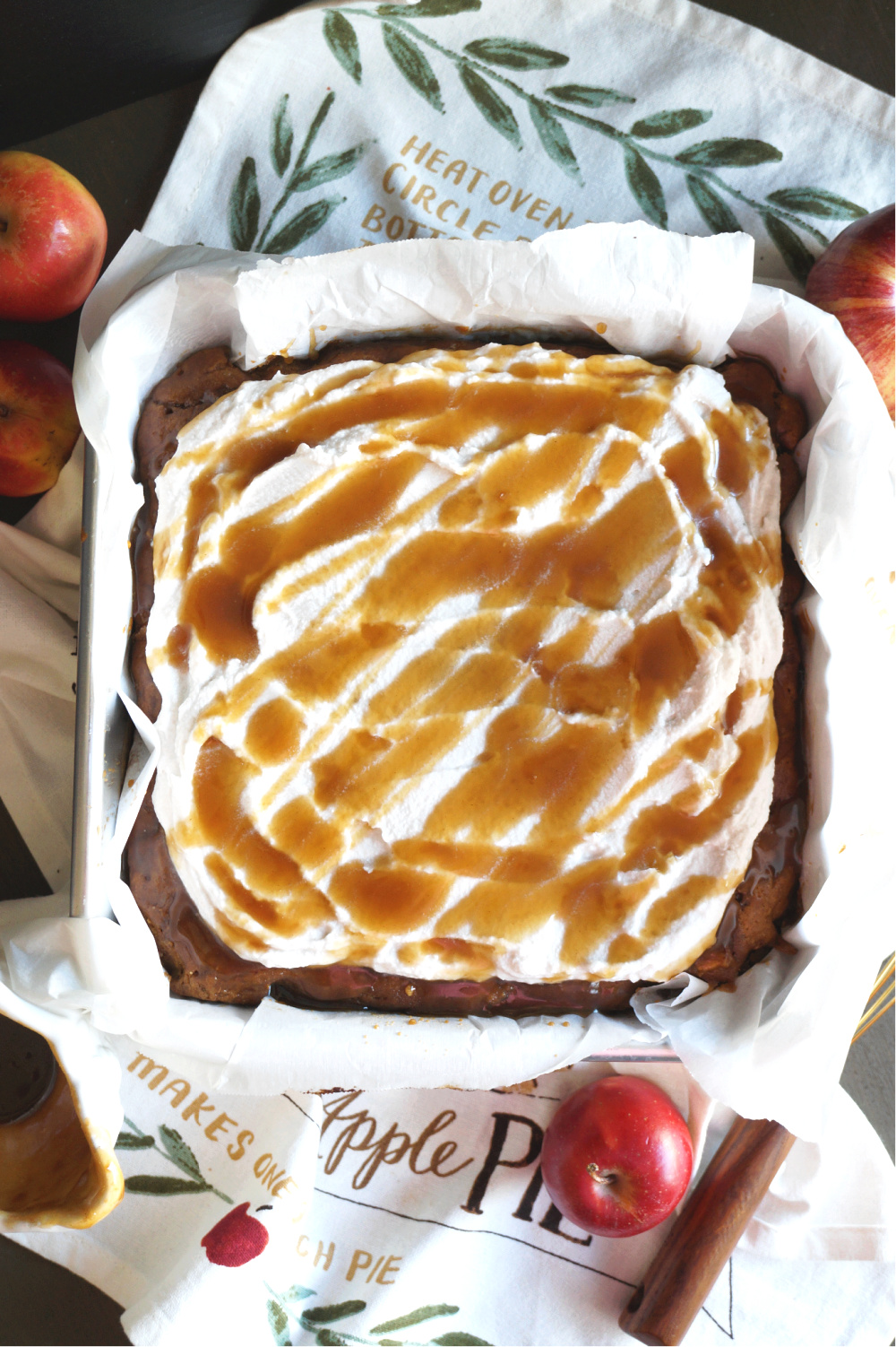 overhead shot of salted caramel apple cake with caramel drizzle