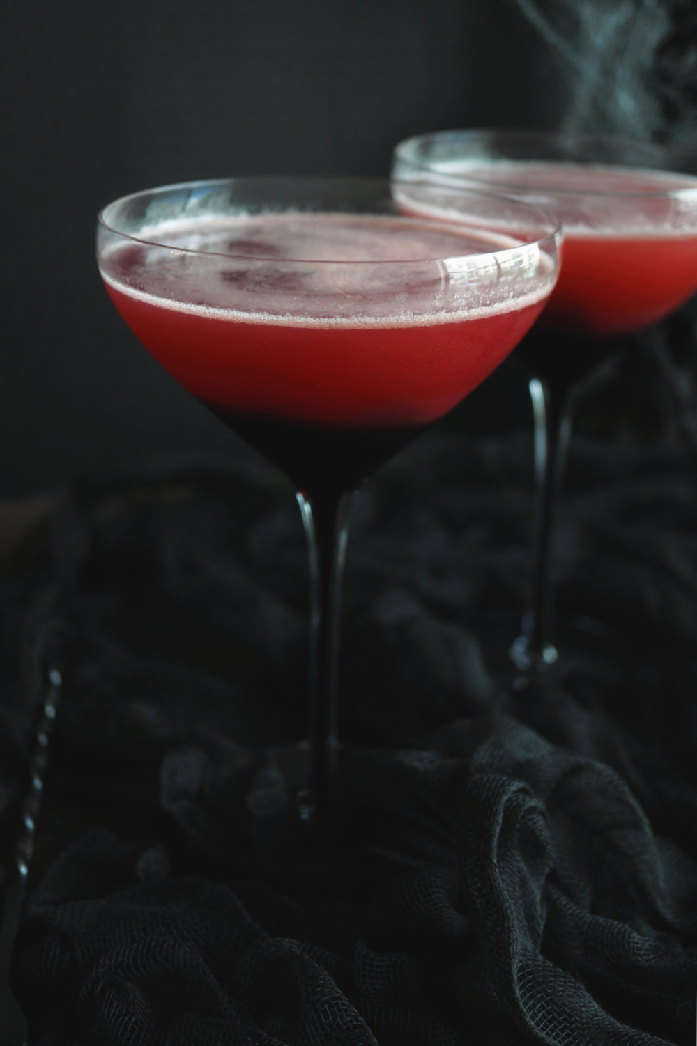 two glasses of red cherry vampire's kiss cocktail