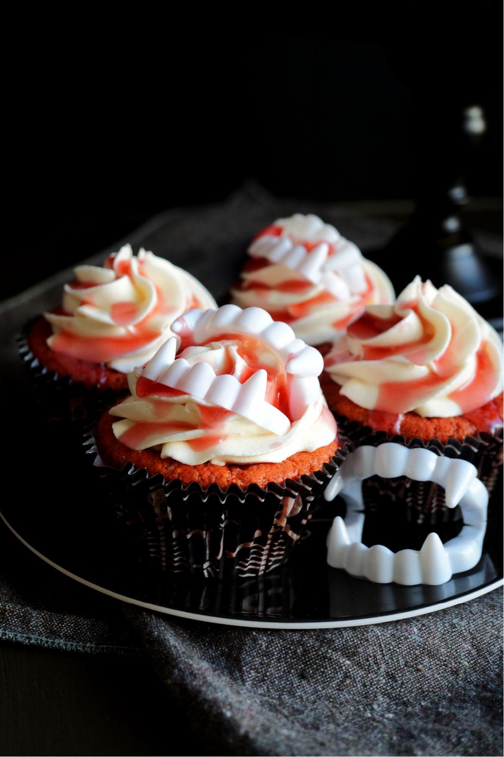 cherry cupcakes with cherry juice and vampire teeth