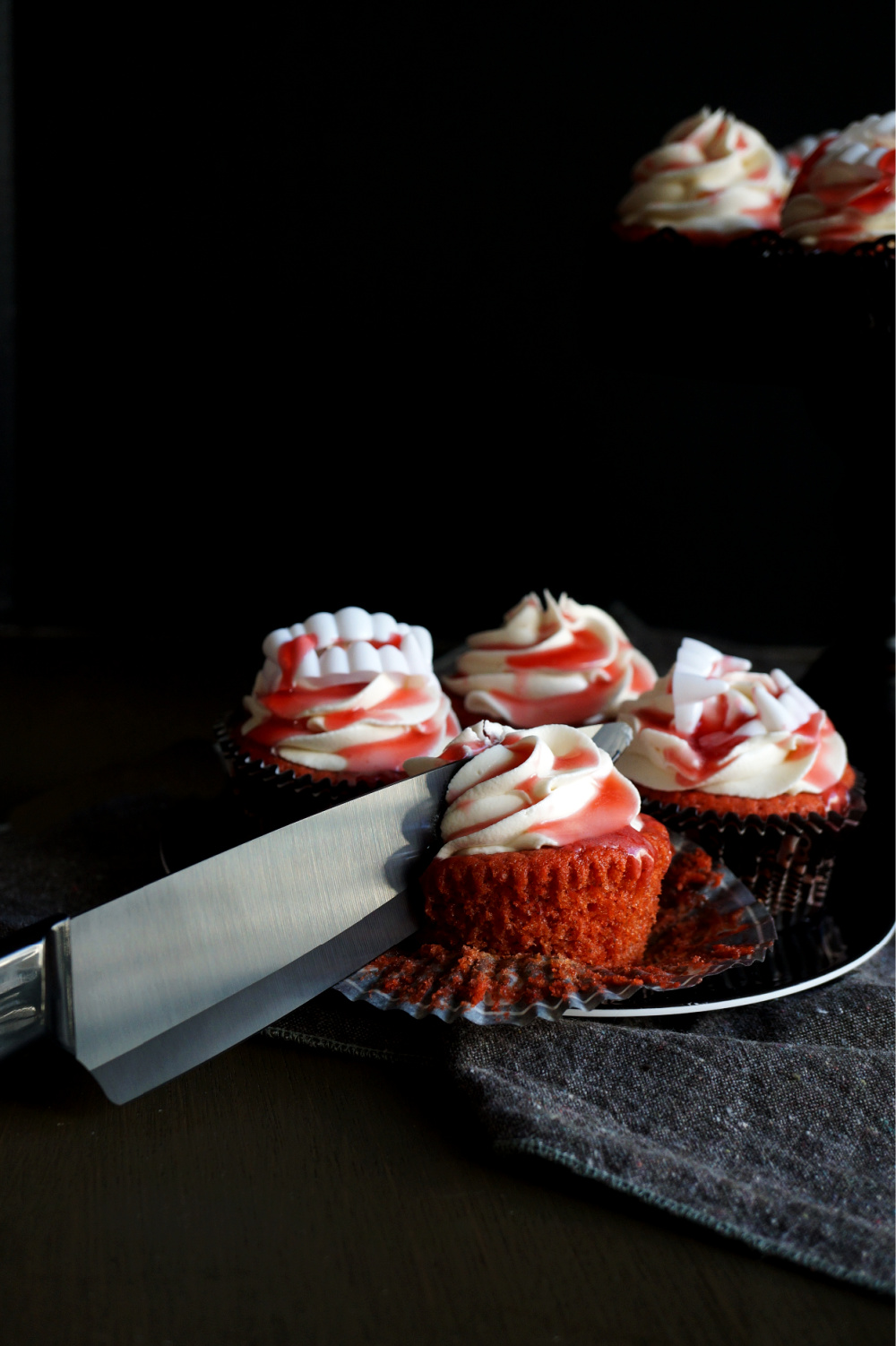 cherry cupcake with knife