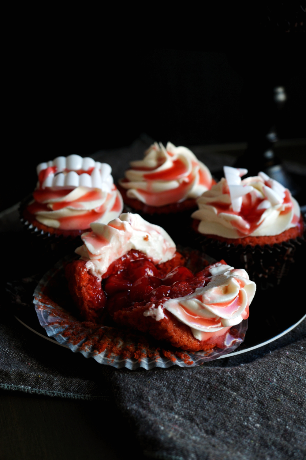 cherry cupcake cut open with cherry pie filling inside