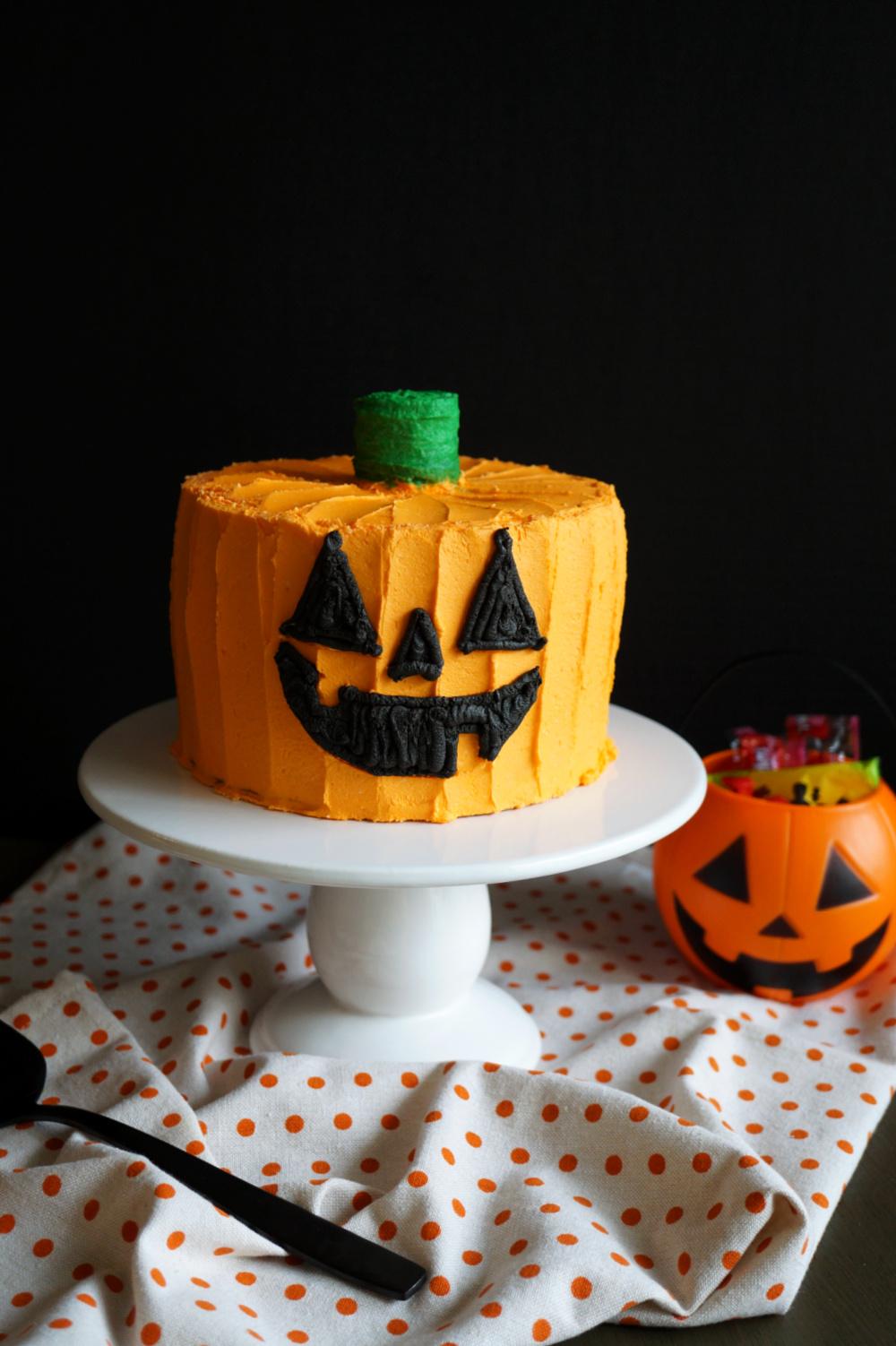 jack o'lantern cake on cake stand
