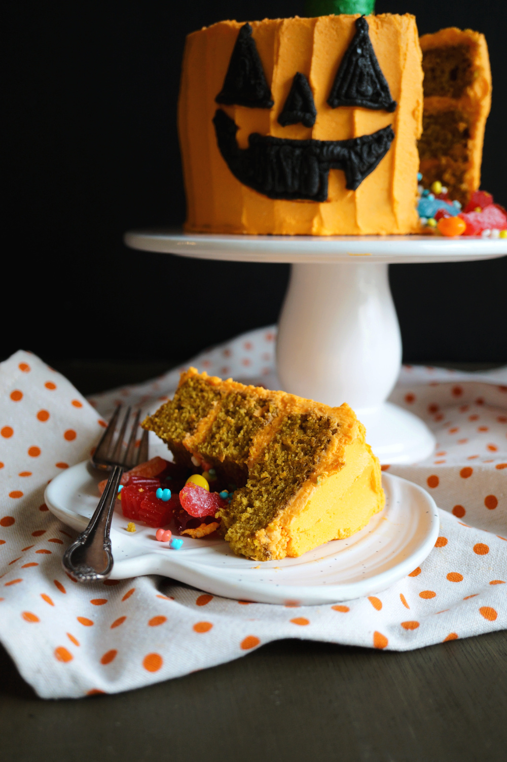 slice of pumpkin cake with candy on plate