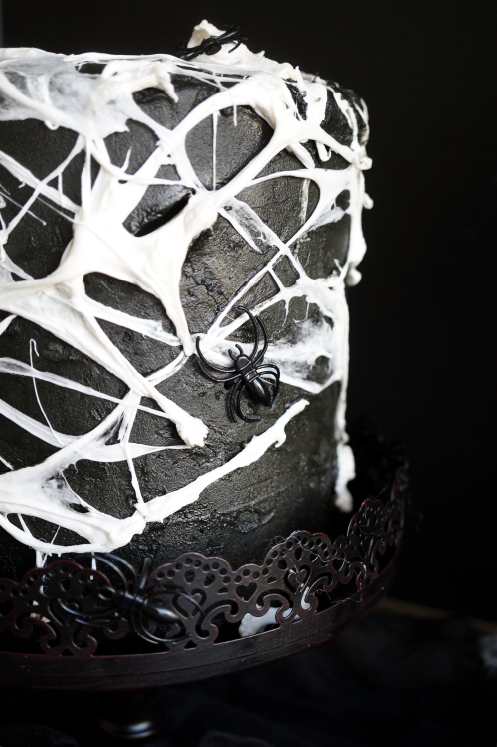close up of side of marshmallow spiderweb cake