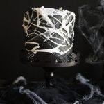 marshmallow spiderweb cake on cake stand